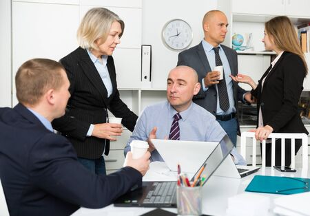 Confident business people planning projects at brainstorming in office