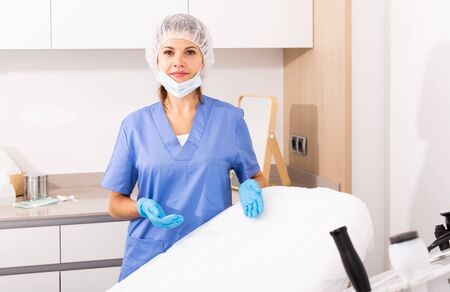Professional female cosmetician welcoming to modern clinic of aesthetic medicine