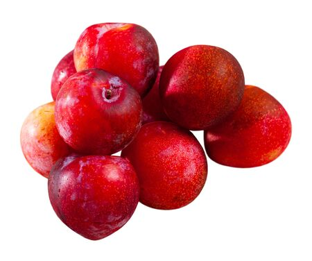 Whole ripe organic red plums. Healthy vitamin product. Isolated over white background