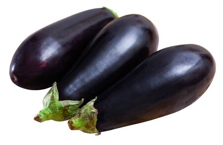 Whole and sliced fresh eggplant on wooden table. Healthy vegetarian ingredient . Isolated over white background