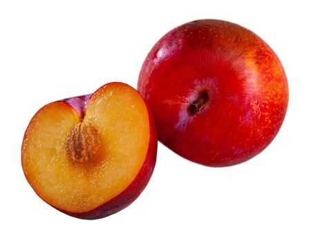 Sliced fresh juicy red plums. Concept of health benefits of fruits. Isolated over white background