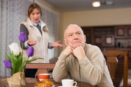 Senior man and woman quarreling at home