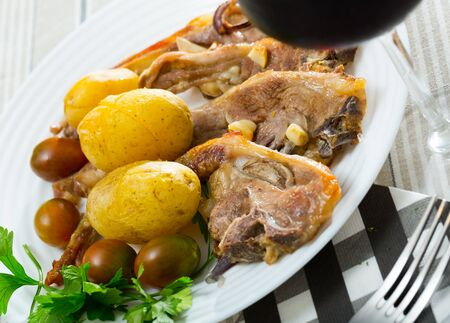 Slow cooked mouton ribs with potato, spanish plate Costillas de cordero