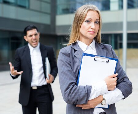 Young woman manager is sading for results of the financial report outdoors. Foto de archivo - 150379562