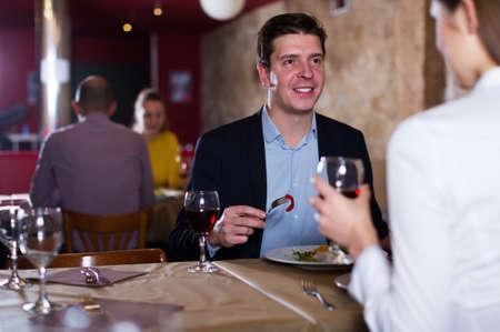 Man with girlfriend in restaurant