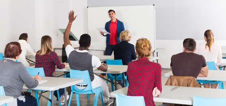 Male teacher lecturing to students