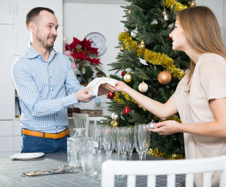 Couple cleaning house for Christmas celebration