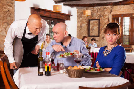 Couple unhappy with quality of food Foto de archivo