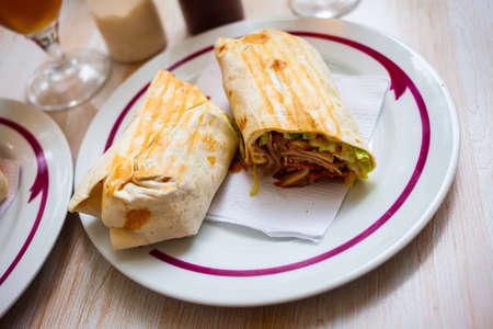Turkish wrapped dish durum halved on plate Zdjęcie Seryjne