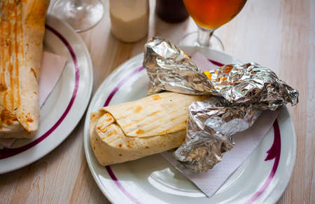 Turkish wrapped dish durum on white plate Zdjęcie Seryjne