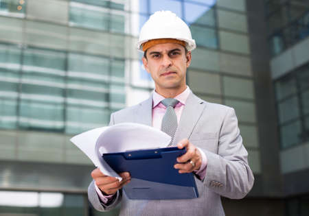 Concentrated businessman reading documents