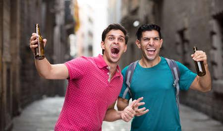 Football fans who are celebrate win of teem Фото со стока