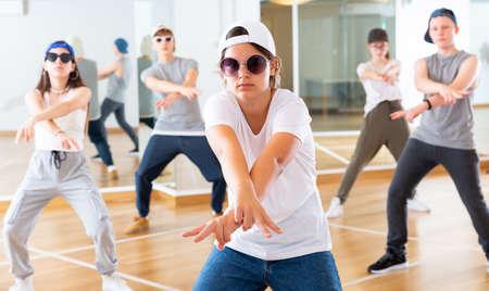 Boy and girls having dancing class Stock Photo