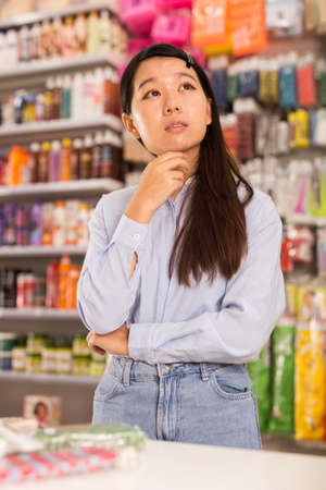Asian woman in cosmetics store