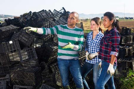 Three positive farmers break in between work on field