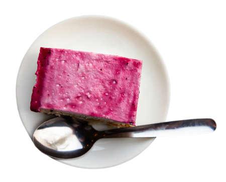 Cake with raspberry glaze on white plate