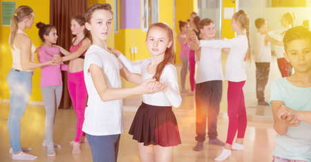 Children dancing slow ballroom dances in pairs Banque d'images