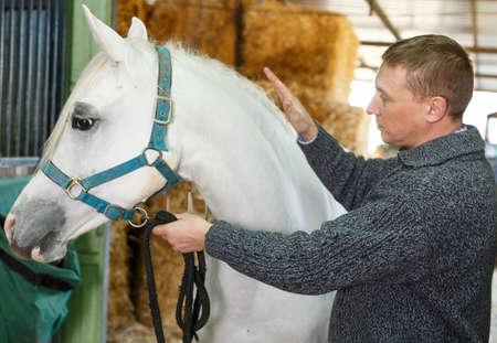 Cheerful man horse farm worker
