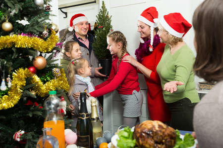 Smiling family is celebrating New Year and meeting Archivio Fotografico