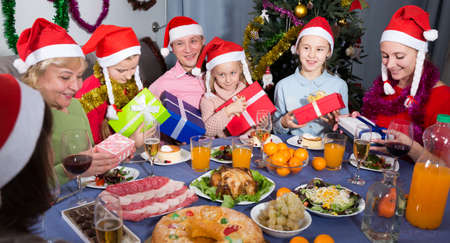 Portrait of happy family who is satisfied of presents in time celebration New Year
