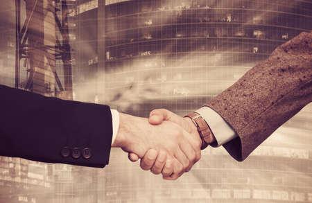 Handshake on background with industrial landscape