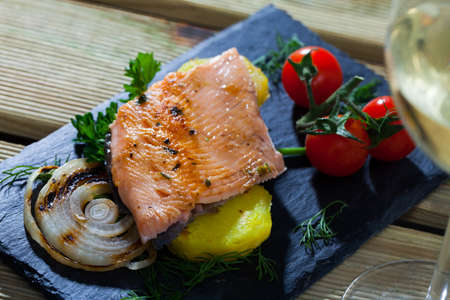 Slate with tender trout fillet, potatoes