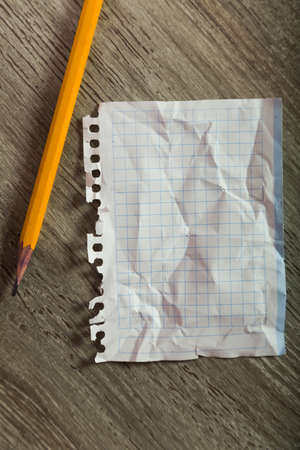 clean crumpled sheet with pencil