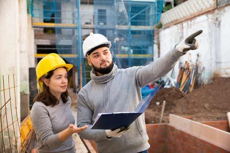 Engineers inspecting process of building overhaul