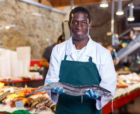 Salesman offering fresh fish