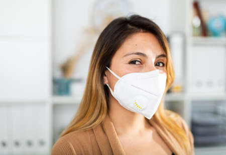 Portrait of businesswoman in face mask