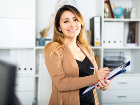 Woman writing down tasks