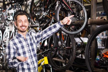 Male customer in bike shop Foto de archivo