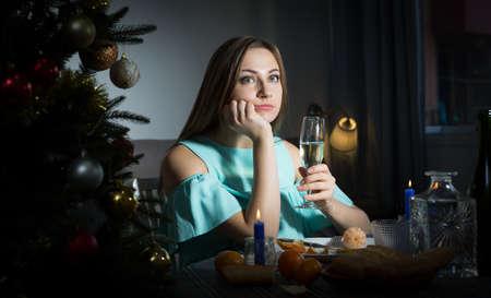 Sad woman celebrating Christmas