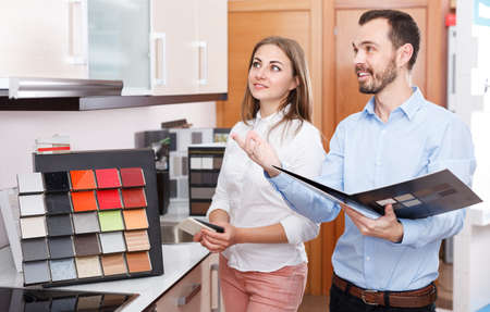 Couple choosing kitchen furniture materials Stok Fotoğraf