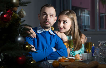 Wife asking for forgiveness from husband at Christmas night