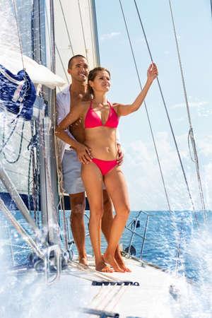 Couple enjoying sea trip on sailboat