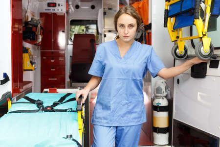 Female emergency doctor in ambulance car