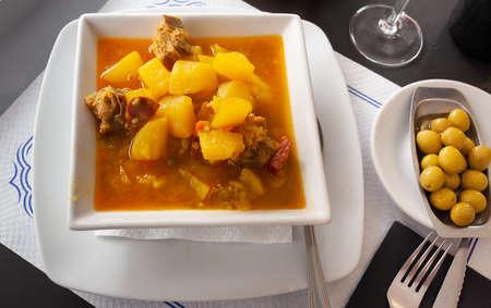 Potatoes with ribs and chorizo. Spanish cuisine
