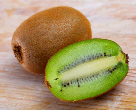 Whole and halved kiwifruits