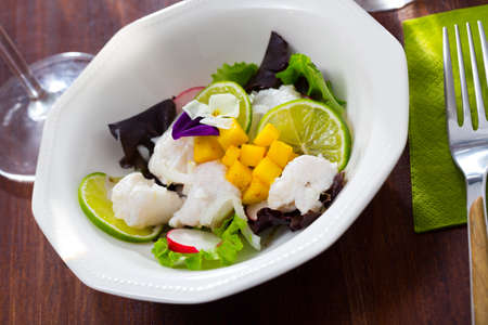 Hake ceviche with mango and lime
