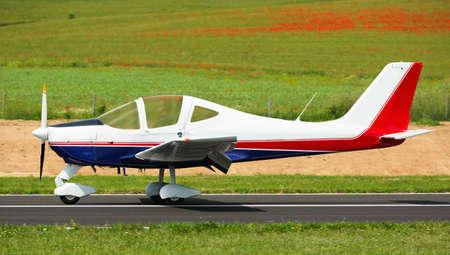Sport airplane taking up from runway Reklamní fotografie