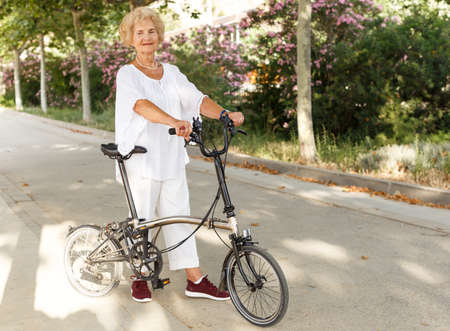 Elderly woman going to biking