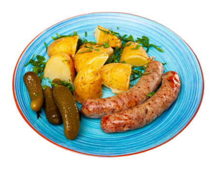 Grilled sausages with boiled potato and gherkins