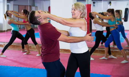 Mature woman training with coach