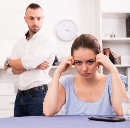 Woman is sad because of the conflict with her husband