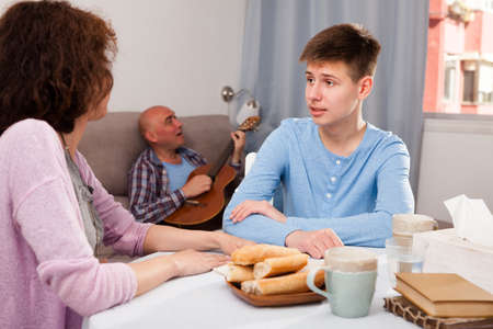 Teenager listening to reprimanding mother Imagens