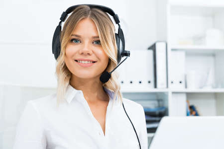 Friendly girl technical support person or call center manager in the office