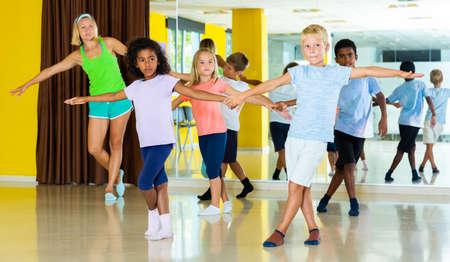 Children learn dance movements in dance class
