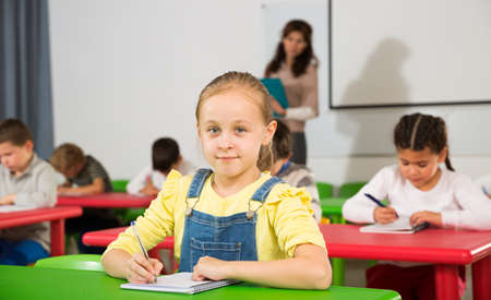 Girl with pen and notebook at lesson