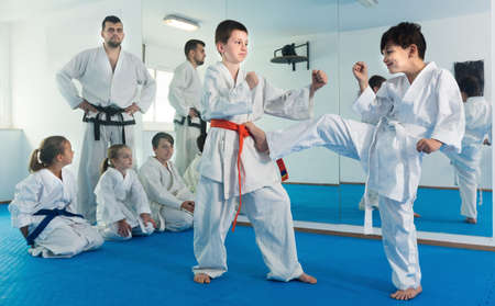 Children trying in sparring to use new technique